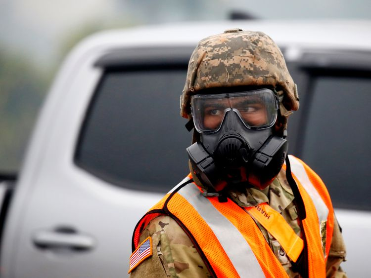 A soldier of the Hawaii Army National Guard wears a mask to protect himself from volcanic gases