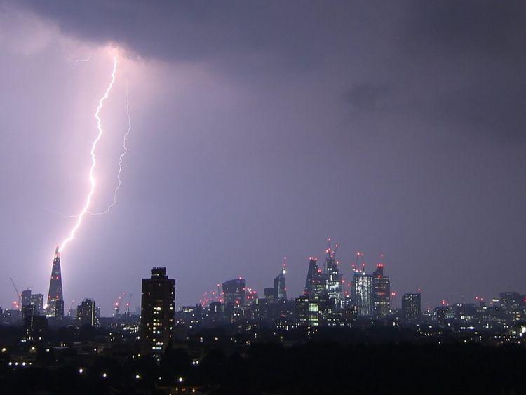 A streak of lightning illuminates London's Shard. Pic. Matthew Smith