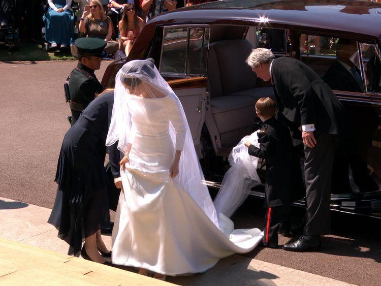 The bride, Meghan Markle, emerges