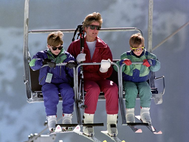 The Princess of Wales rides a chair lift up the Kriegerhorn with her sons Prince William, left, and Prince Harry in 1991
