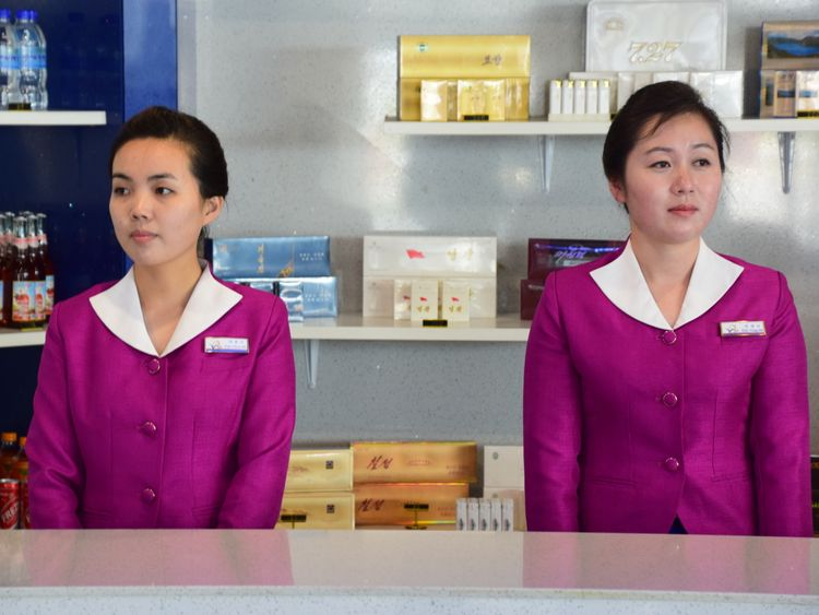 Two North Korean women at an airport kiosk in Wonsan. Pic: Michael Greenfield
