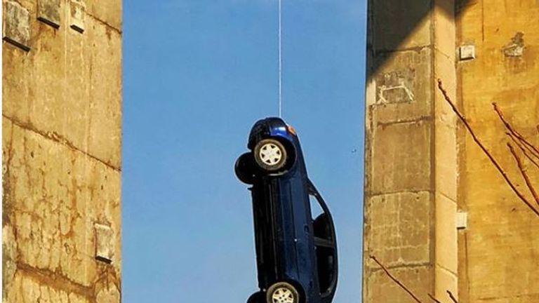 Car left dangling from Millwood Overpass Bridge in Toronto