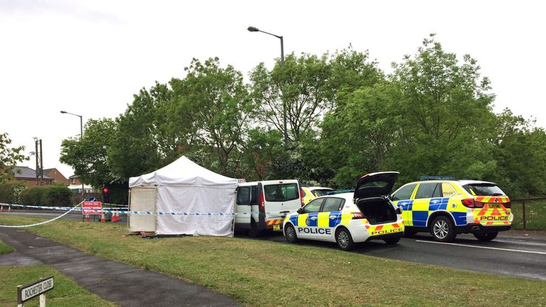 A forensic tent has been set up at the scene of the shooting