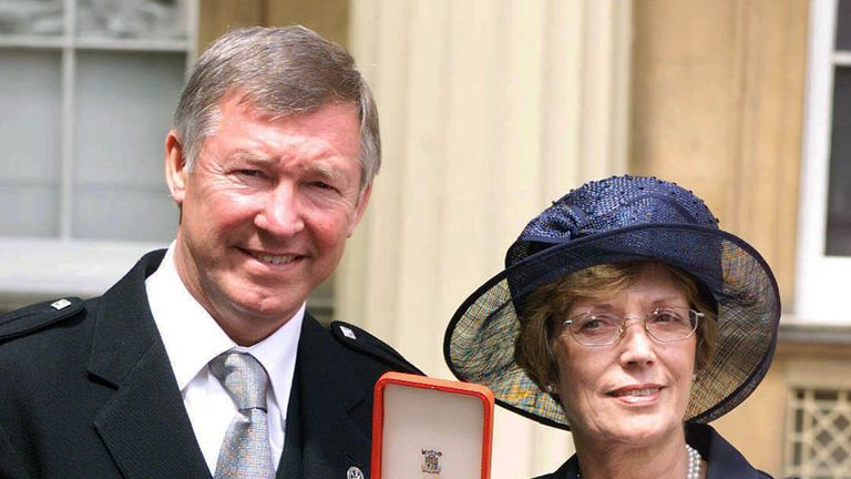 Jul. 1999 Manchester United manager Sir Alex Ferguson and wife Cathy pose for photographs July 20