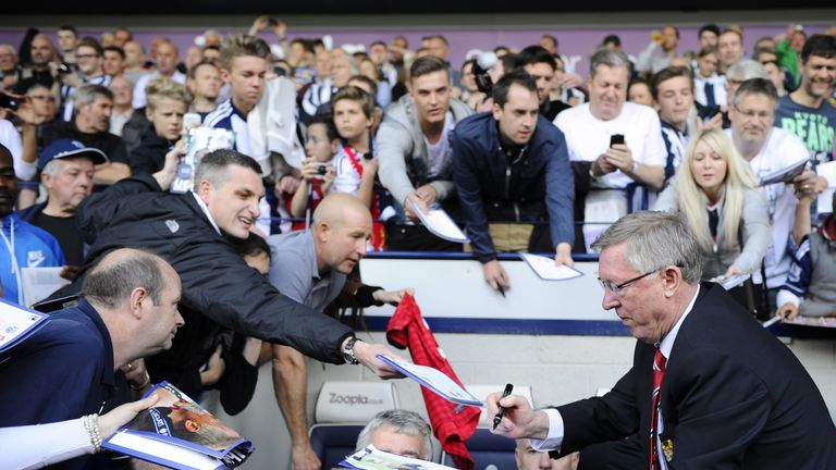 Manchester United manager Alex Ferguson signs autographs to fans before the start of the English Premier League football match between West Bromwich Albion and Manchester United, his last game before retiring, at The Hawthorns in West Bromwich, central England, on May 19, 2013