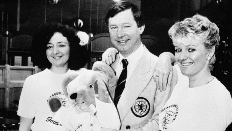 Scotland manager Alex Ferguson wished bon voyage by Glasgow Airport staff when they presented him with a mascot as he left with the squad for the World Cup in Mexico in 1986