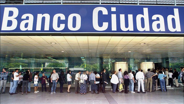 A long queue of people wait to get into a bank in Buenos Aires more than 17 years ago
