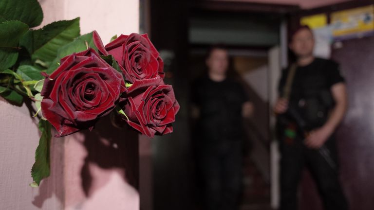 Flowers have been left at the apartment building where Mr Babchenko was shot