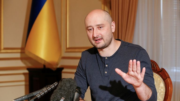 Arkady Babchenko speaks during an interview with foreign media   after faking his death