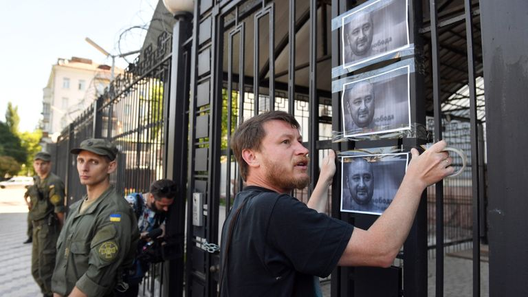 An activist put up photos of Mr Babchenko outside the Russian embassy after believing he was dead