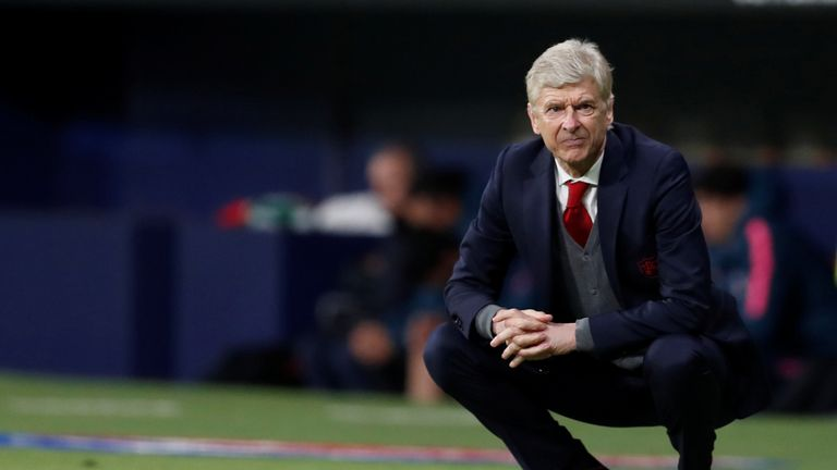 Arsene Wenger looks on helplessly as his side fall to European disappointment