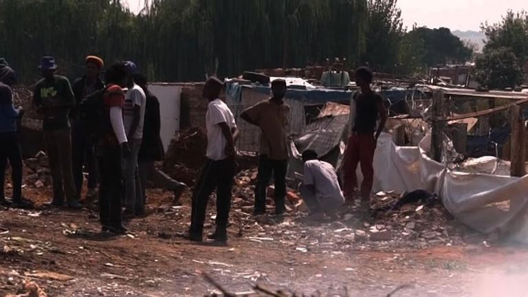 Nyaope users gather in a rubbish dump