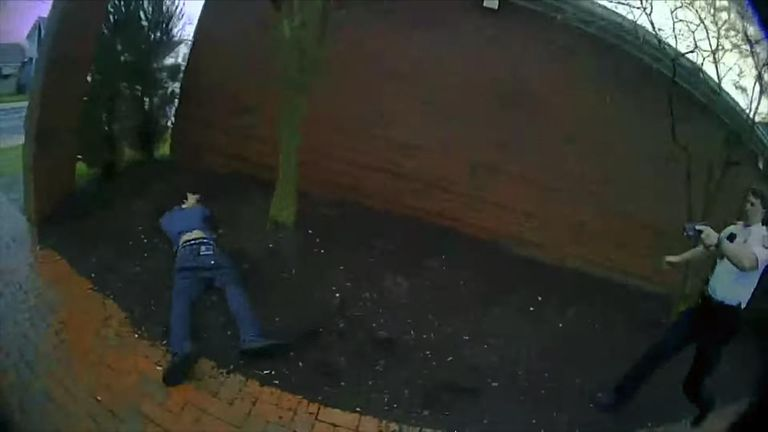 Bodycam footage shows the suspect on the ground