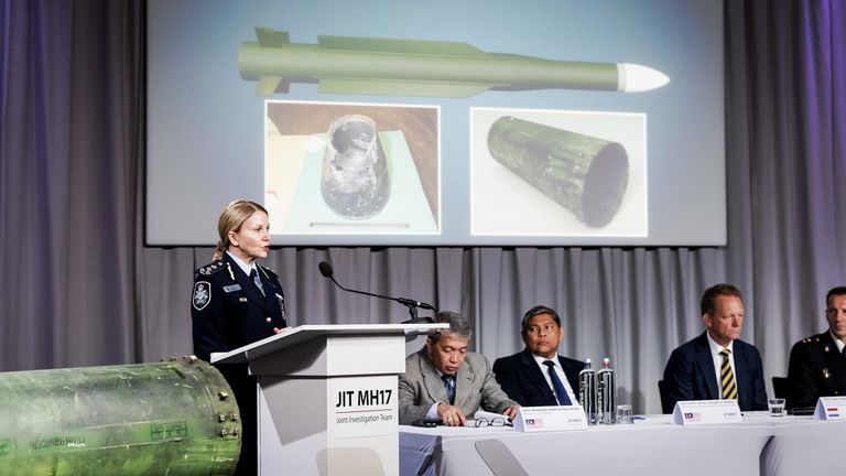 Part of the BUK missile (left) was displayed at the investigation's media confernce