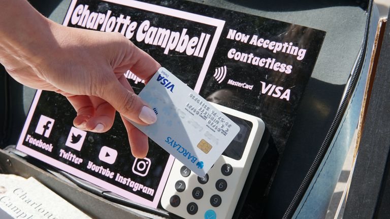 Charlotte Campbell in London trialling the contactless payment scheme for buskers