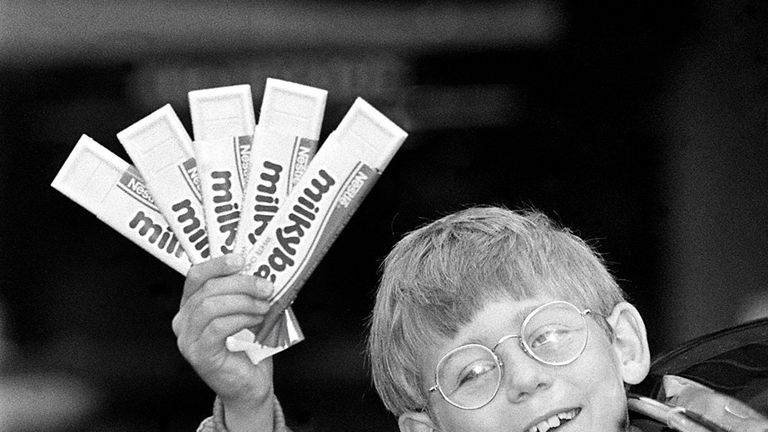 "Nestle's new and 7th Milky Bar kid, Antony Eden, nine, with a fistful of the white chocolate bars, setting out to see London by limousine, after beating 2,500 young hopefuls wanting to say the final line ""The Milkybars are on me!"" in TV commercials."