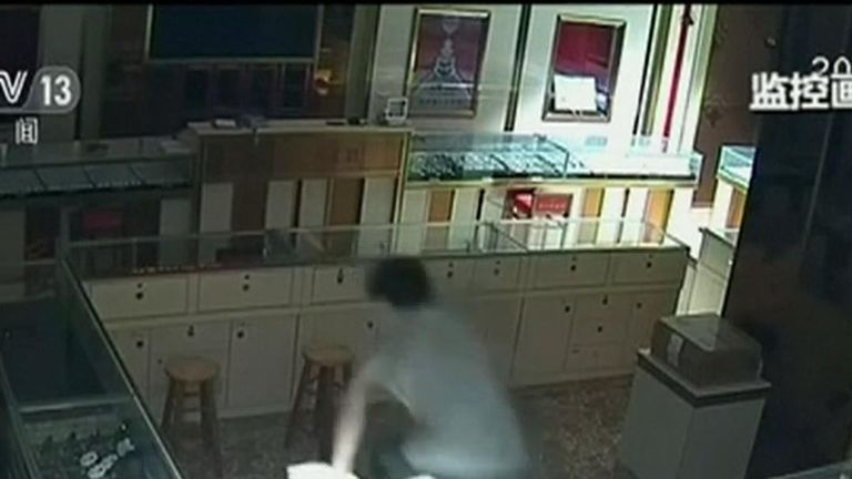 The alleged jewel thief was seen sitting outside the jewellery shop in Dongguan, south-eastern China in the early hours on May 13, before making his move. The shop's staff were unaware of the burglary until the following morning when they discovered dozens of items missing, according to the report.