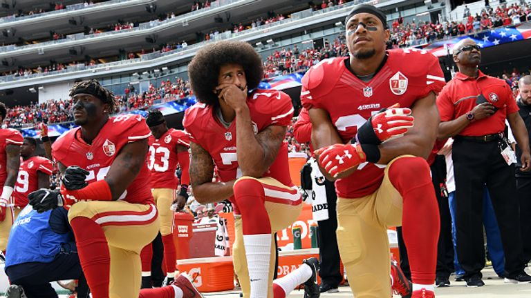 Colin Kaepernick, centre, started the kneeling protest movement in 2016 pre-season match