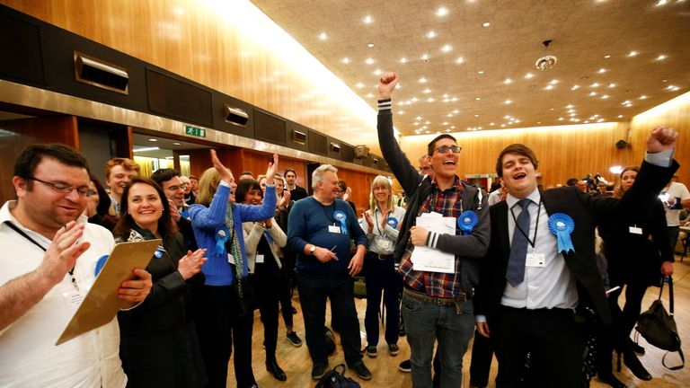 Supporters of the British Conservative Party react during the count at Wandsworth Town Hall