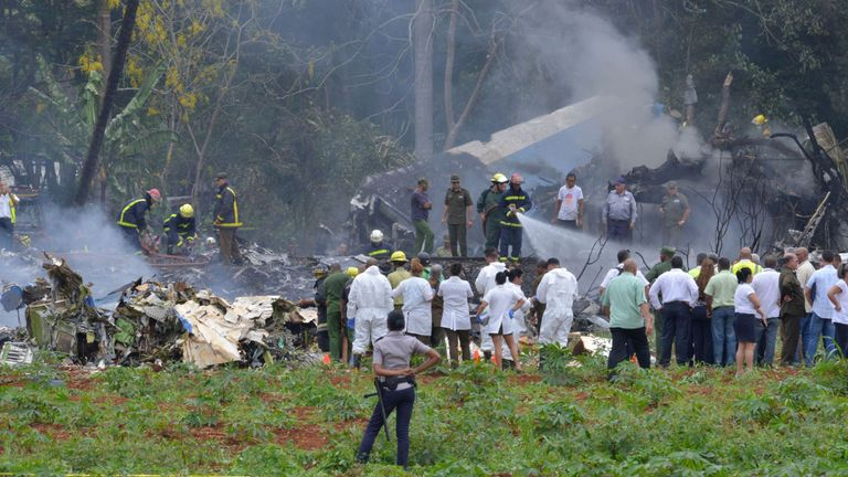 Firefighters douse the burning wreckage