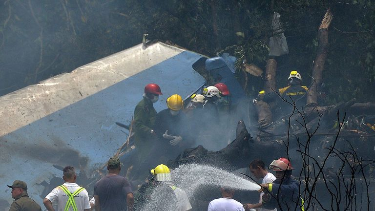 Emergency services workers dousing