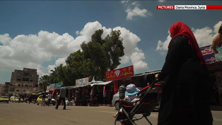 Residents shop for food in the town centre of Daraa