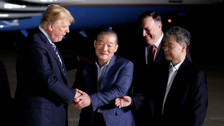 Donald Trump greets the Americans formerly held hostage in North Korea upon their arrival at Joint Base Andrews
