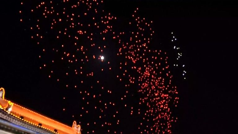 :Lighting up the sky of Chinese ancient city of Xi'an, 1,374 illuminated drones broke a Guinness World Record on Sunday (April 29) for the most unmanned aerial vehicles simultaneously airborne.