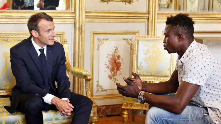 Emmanuel Macron with 'spiderman' hero Mamoudou Gassama