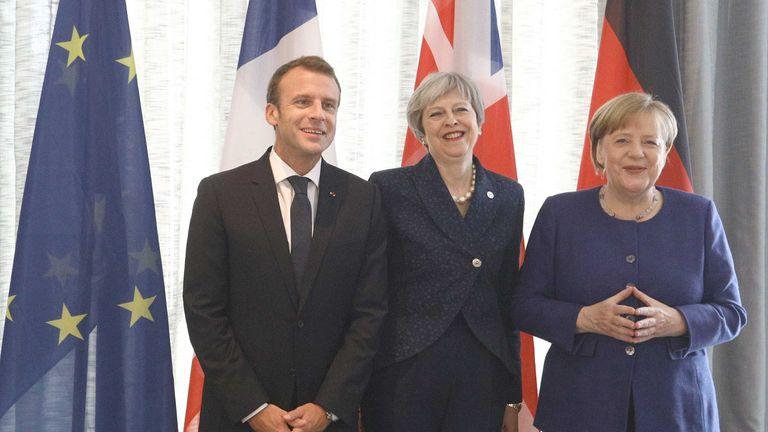 Emmanuel Macron, Theresa May and Angela Merkel