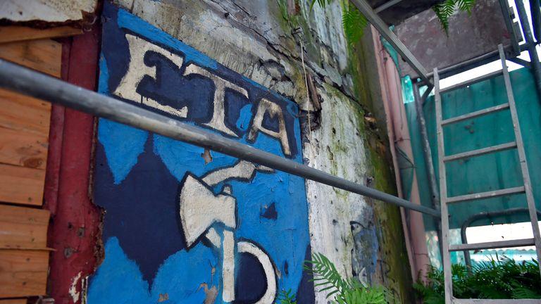 Old graffiti of the ETA logo in the village of Bermeo, northern Spain