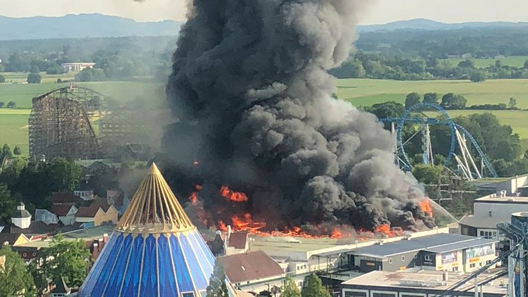 A black column of smoke rises from a warehouse in flames above the amusement park 'Europapark' in Rust, southern Germany on May 26, 2018.