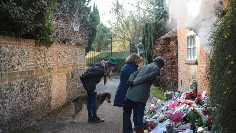 Flowers have mounted up outside the home in Oxfordshire home where Michael died