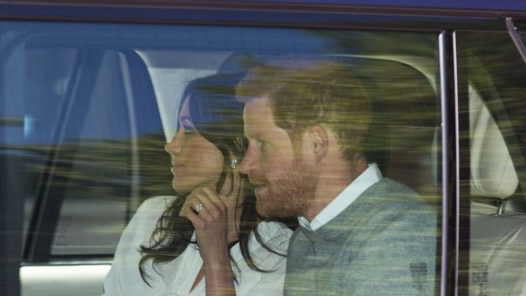 Prince Harry and Meghan Markle pictured leaving Kensington Palace as they head to Windsor for wedding rehearsals