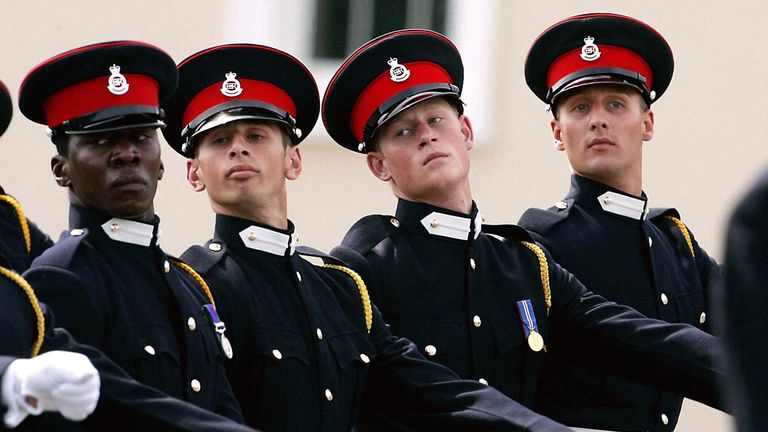 Britain's Prince Harry (second right) marches during a review parade at Sandhurst