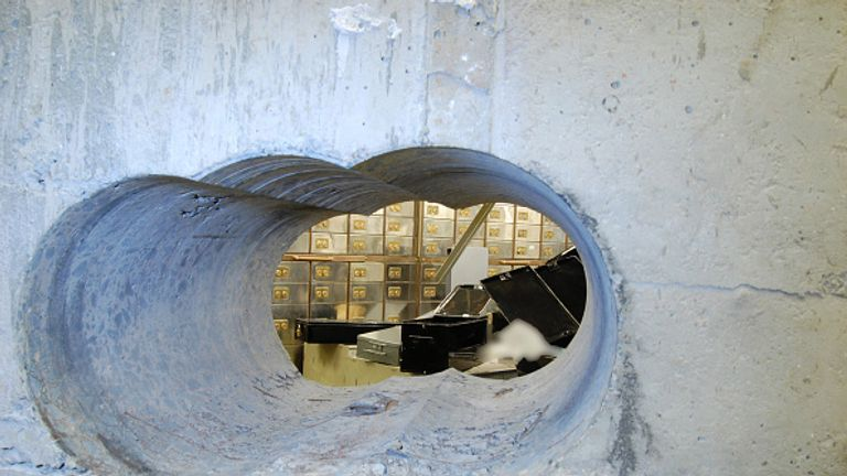 The burglars used a drill to bore a hole in the wall of the vault