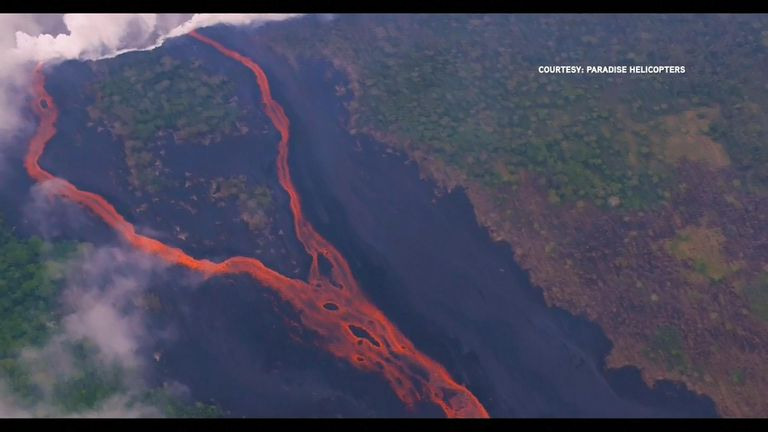 Steam clouds are released where the lava hits water