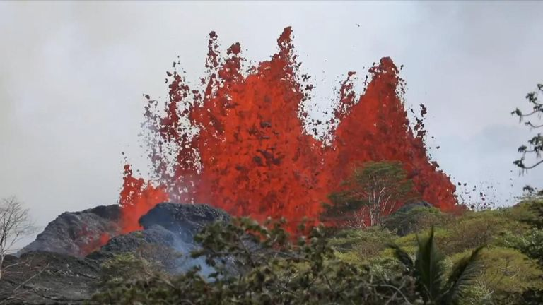 Lava erupts from an underground chamber below the fissure