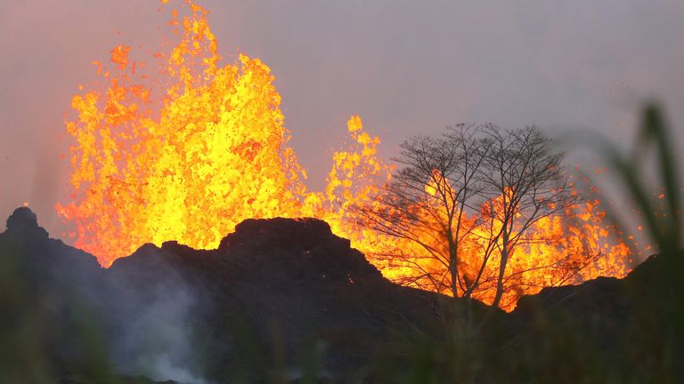 Lava from a crack erupts on Hawaii's Big Island days after the main volcano sent a plume of about 9,144m into the sky