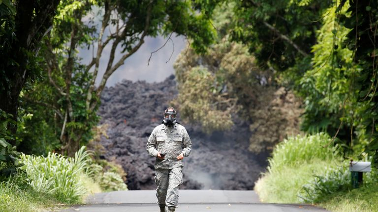 Lieutenant Colonel Charles Anthony, of the Hawaii National Guard, measures sulfur dioxide gas levels