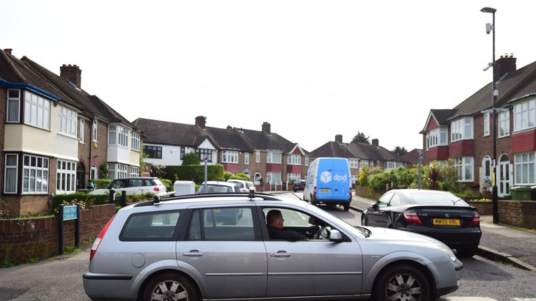 A man parks a car on the entrance to South Park Crescent, Lewisham to stop the funeral cortege of burglar Henry Vincent