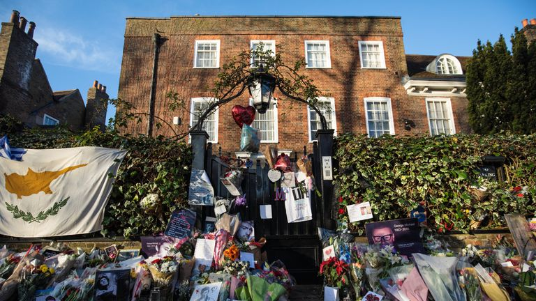 The family of George Michael have asked for flowers and messages to be removed from outside his Highgate home