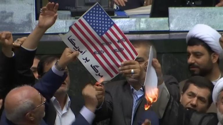 Iranian lawmakers have set fire to a paper US flag in the parliament in Tehran