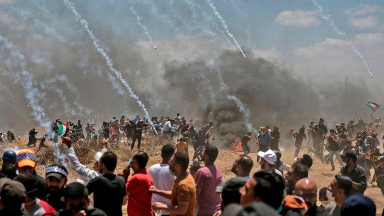Israeli forces fire tear gas at Palestinians near the border