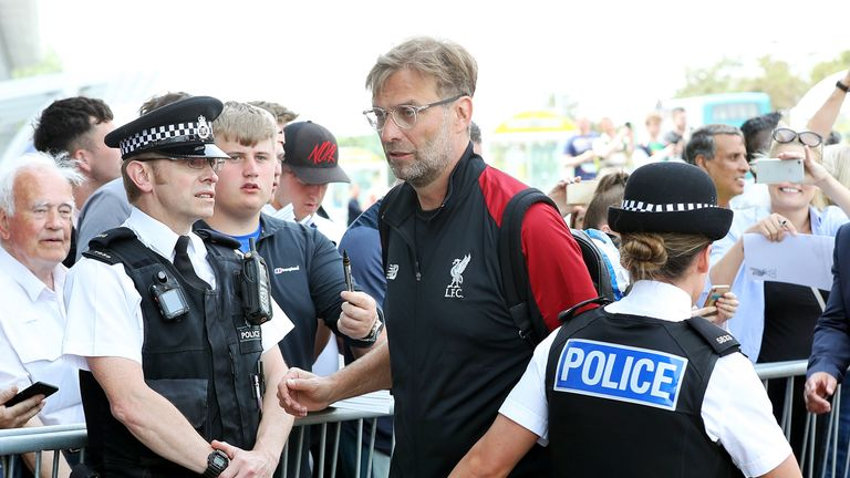 Manager Jurgen Klopp arrives at Liverpool John Lennon Airport with his team on Thursday