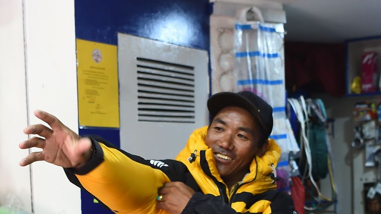 In this photograph taken on March 26, 2018, Nepali mountaineer Kami Rita Sherpa, 48, tries on a climbing jacket in Kathmandu