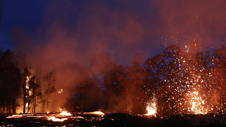 Lava erupts following eruptions at the Kilauea volcano on Thursday