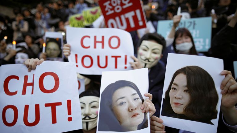 People hold portraits depicting Cho Hyun-ah and Cho Hyun-min, daughters of Korean Air Lines' chairman Cho Yang-ho as they take part in a protest against the abuse of power by them, in central Seoul, South Korea, May 4, 2018. REUTERS/Kim Hong-Ji NO RESALES. NO ARCHIVES