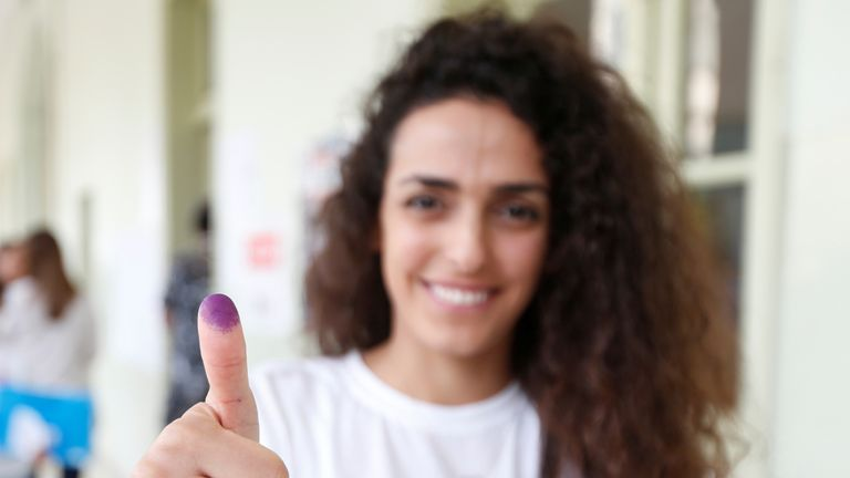 A woman shows her ink-stained finger after casting her vote during the parliamentary election in Beirut, Lebanon, May 6, 2018. REUTERS/Jamal Saidi