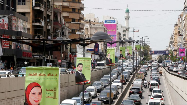 Campaign posters of Lebanese parliament candidates are seen in Beirut, Lebanon May 2, 2018. REUTERS/Mohamed Azakir